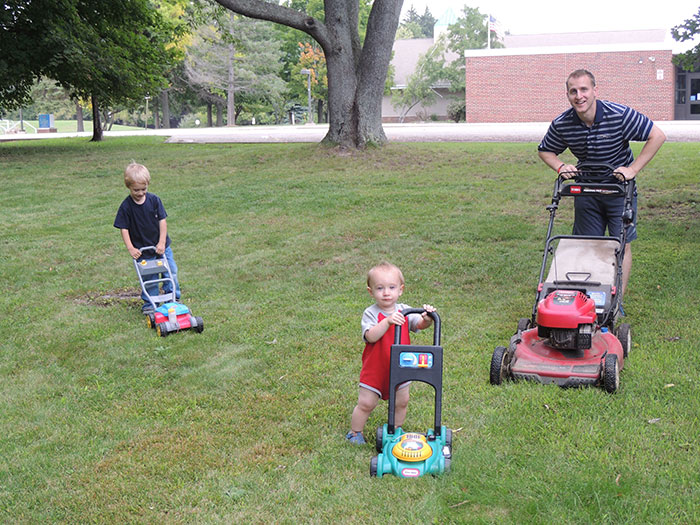 Matt lawn mowing with sons