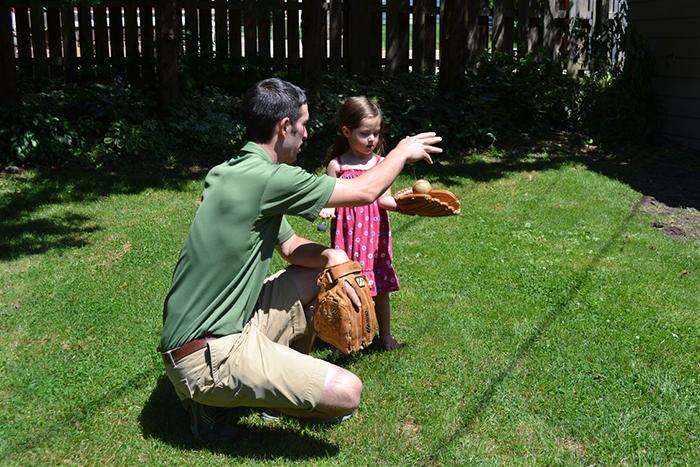 Josh teaching Anneliese how to throw