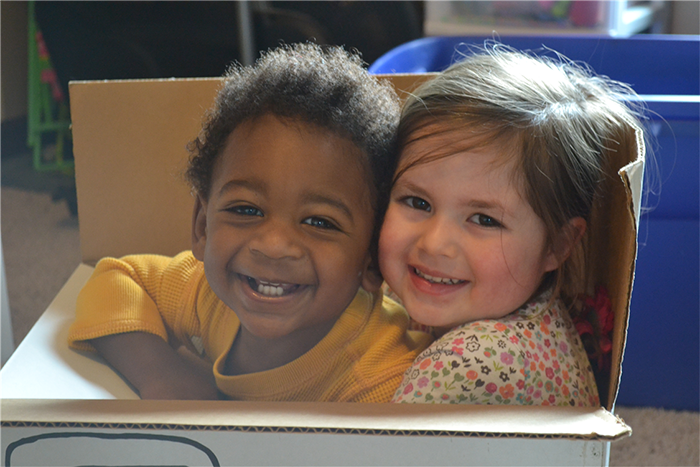Anneliese and Jamin smiling in box